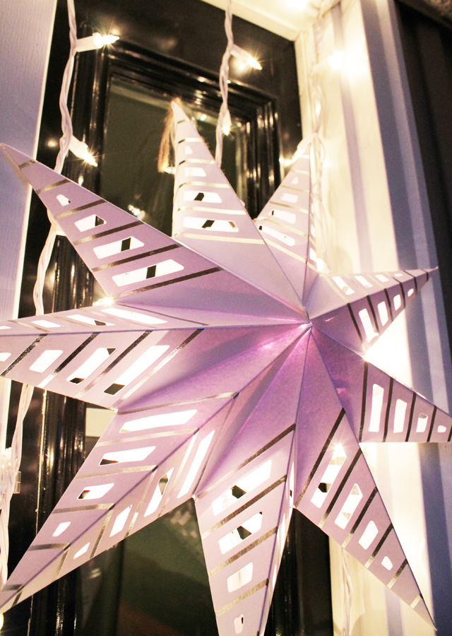 Paper star lit at night
