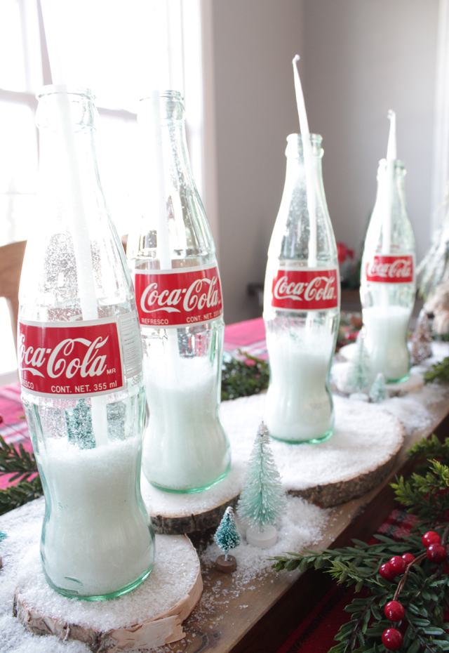 Snowy candlesticks with glass bottles